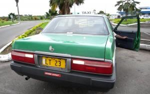 Rear view of Nissan Cedric taxi in Fiji