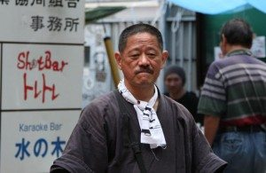 Yusuke Hama performs during a festival at the entrance to the Golden Gai entertainment area of Shinjuku