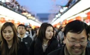 Shoppers shuffle through the Nakamise shopping arcade in Tokyo's Asakusa district