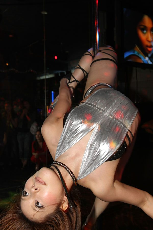 Pole dancers perform at club IBEX in Tokyo's Roppongi district