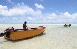 Fisherman in lagoon