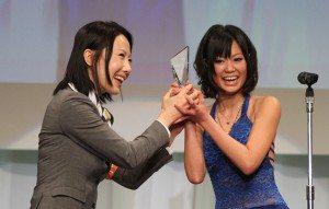 Uta Kohaku (right) of Paradise TV wins Best Production in HD for 'No Panty News' at 2011 porn awards