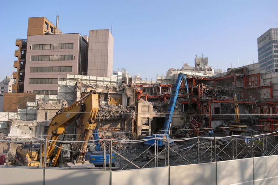 View of TSK.CCC building during demolition in 2008 with Roppongi Hills at right