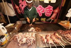 A grilled squid vendor
