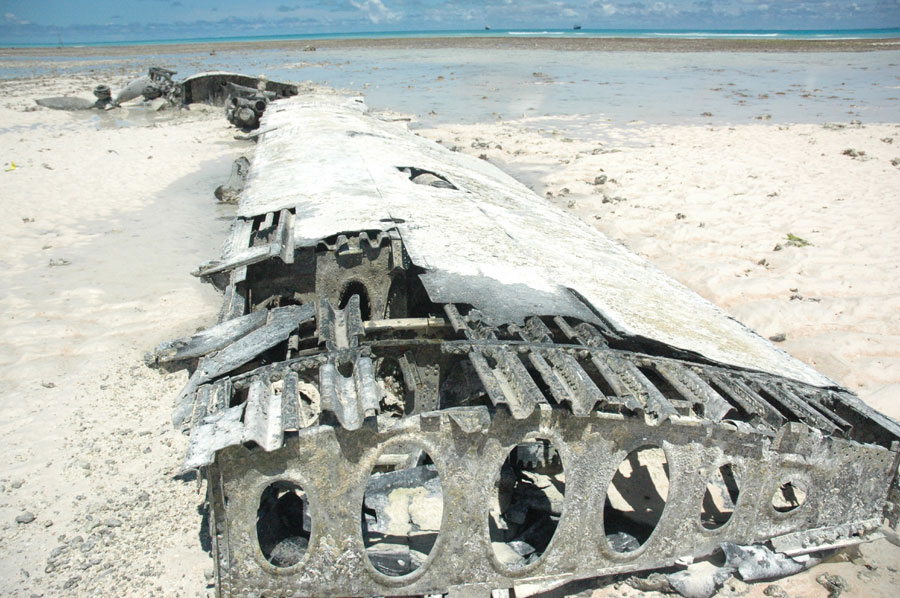 Pieces of a B-24 Liberator rests in the lagoon of Tarawa