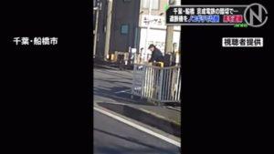 A man cut a railroad crossing gate in Funabashi City on Saturday