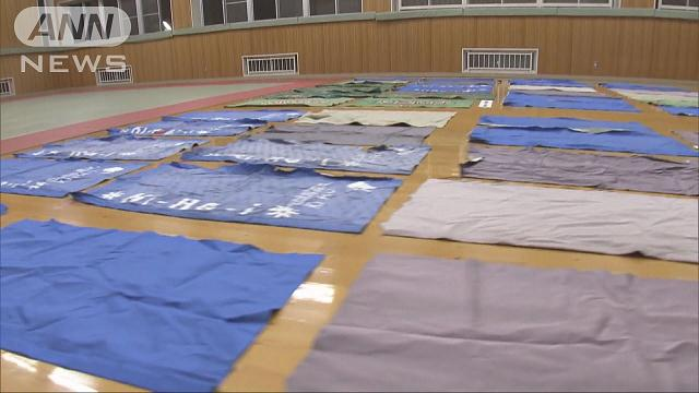 Police found about 100 photo booth curtains in the home of a man in Toki City