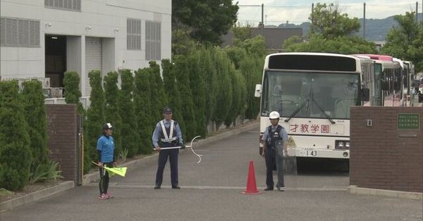 A man is at large after slashing a woman with a knife at a school in Matsumoto City on Monday