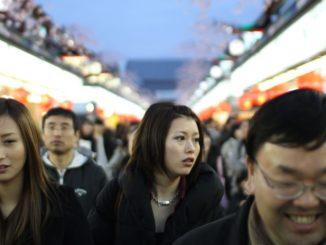 Shoppers shuffle through the Nakamise shopping arcade
