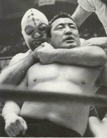 The Destroyer puts Rikidozan in a headlock
