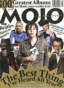 Elvis Costello (far right) holds the self-titled release of Ron Sexsmith on the cover of the January, 1996 issue of Mojo magazine