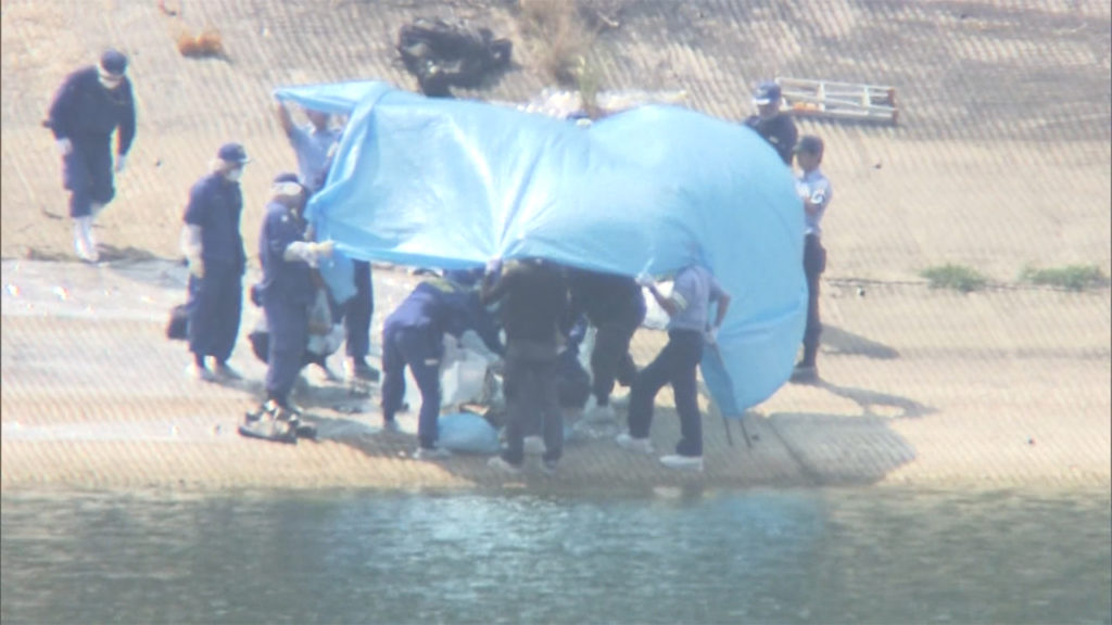 A woman's corpse was found in a plastic case at Gongen Dam in Kakogawa City on Saturday