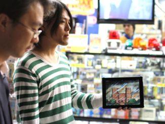 Yuta Sasaki with his iPad in Akihabara