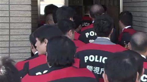 Investigators entered the Kodo-kai headquarters on Tuesday