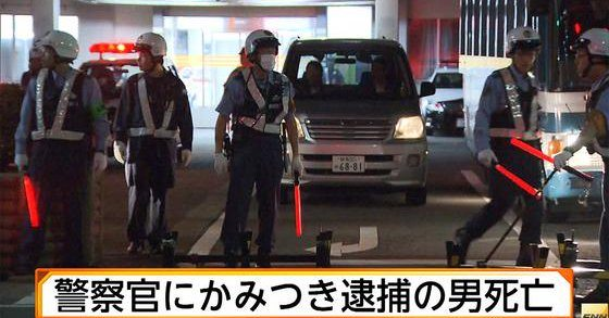 A gangster died after biting two officers while being restrained (Fuji News Network)
