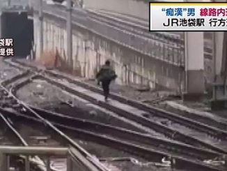 A man jumped onto railway tracks at Ikebukuro Station on Tuesday morning after being accused of groping a woman