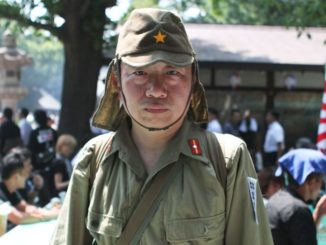 A man dresses as a soldier at Yasukuni Shrine on August 15
